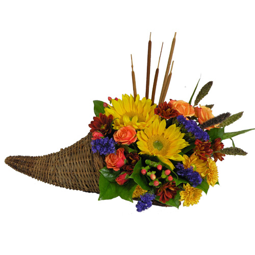 Along with joy, this cornucopia carries an abundance of beautiful fall flowers and foliage. A stunning centerpiece or inviting entryway display, this beauty will be at home anywhere in the house. <br/><br/>