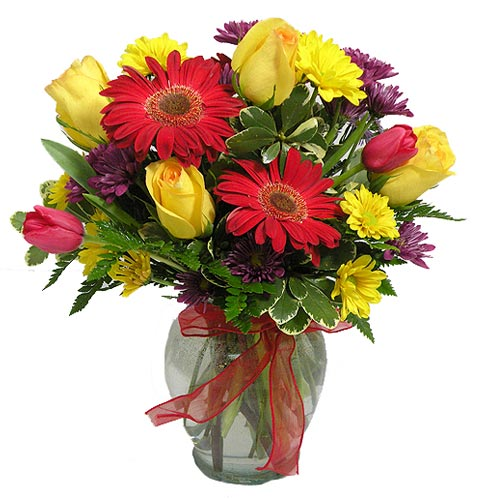 A Wylie Flower Shop exclusive. Bring cheer into any dreary day with this colorful ray of sunshine! <br/><br/>
